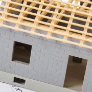Home Construction Plans and Small Scale Model of Home on a Table